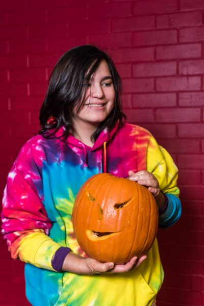 Melissa Dow and her scary pumpkin. Photo by Sasha Hill