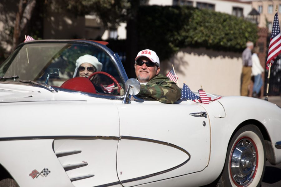 Retired Navy veteran of 22 years Vince Lopez drives his 1959 Corvette in the annual Veterans Day parade with the 'Vettes for Vets car club. Photo by Jason Stilgebouer