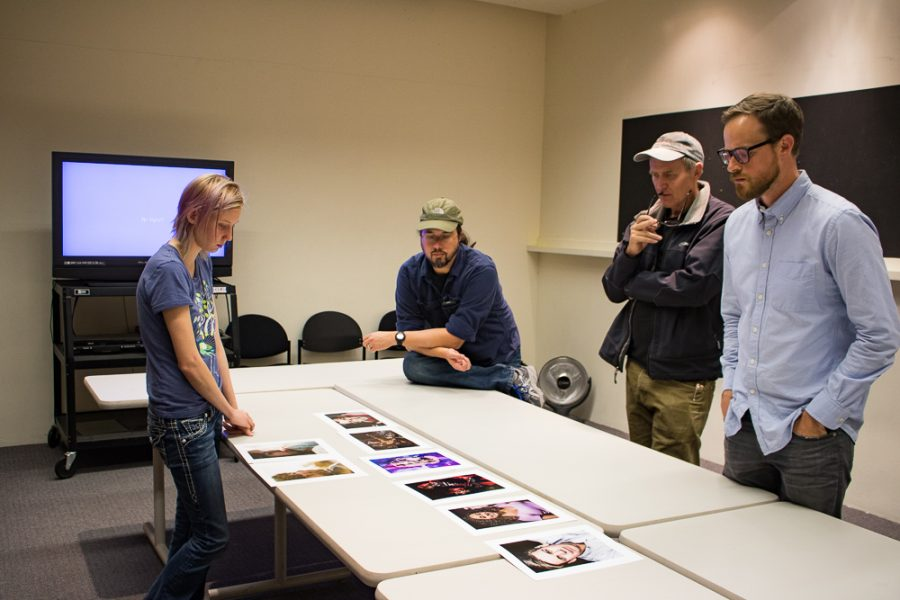 Senior photography major Christina Marshall lays out her work. Photo by Chris Dorantes